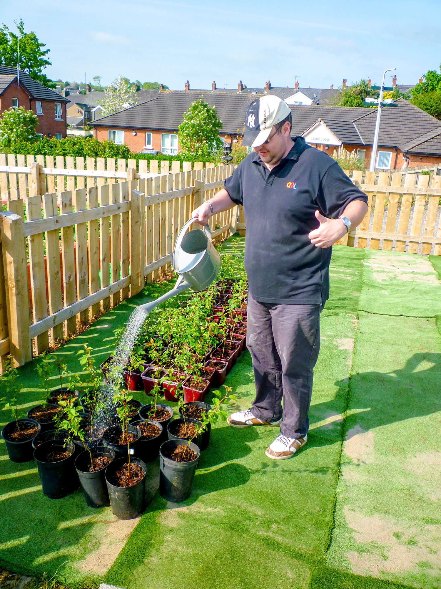 Watering plants at the Allotments at AEL
